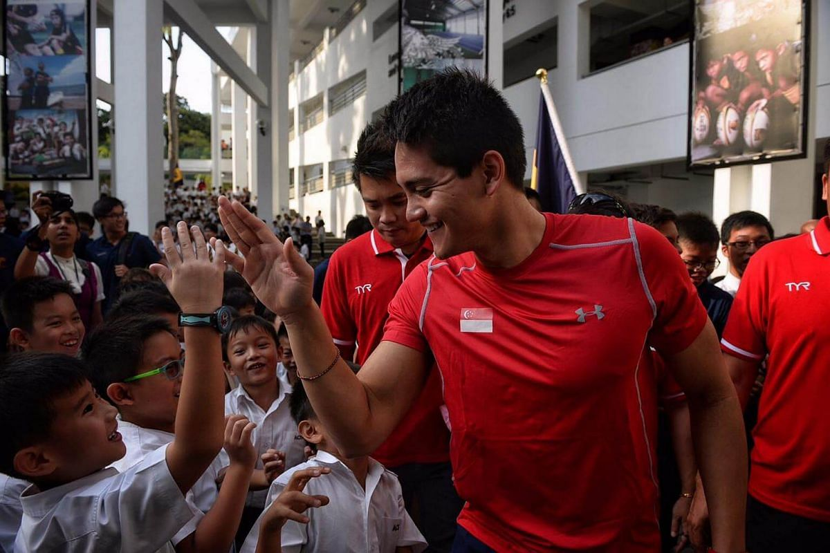 Joseph Schooling greeting the Primary 1 and 2 children at ACS Junior on August 16.