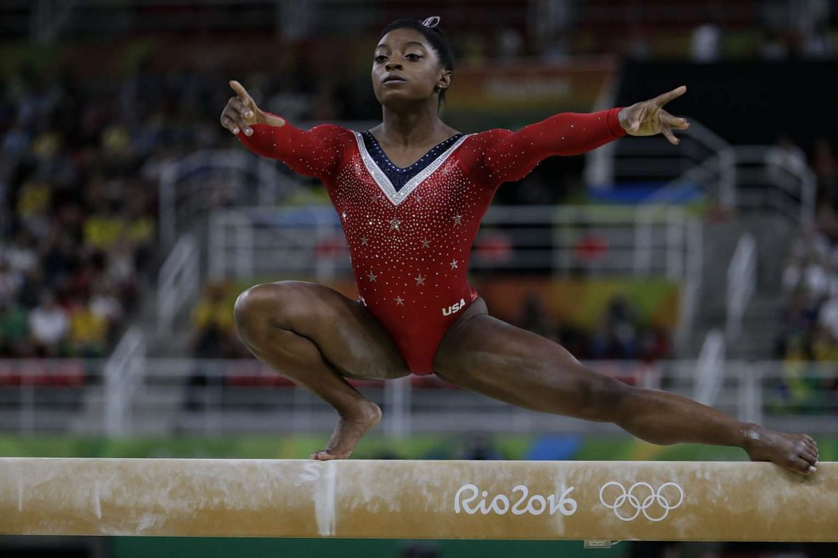 Simone Biles of the US executing her routine during the artistic gymnastics women's balance beam final at the Rio Olympic Arena in Rio de Janeiro on August 15.