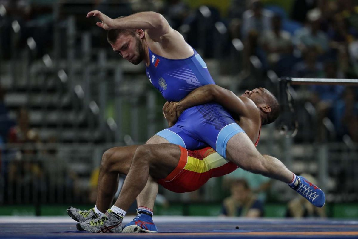 Davit Chakvetadze (in blue) of Russia in action against Zhan Beleniuk of Ukraine during the men's Greco-Roman wrestling 85kg gold medal match at Carioca Arena 2 in Rio de Janeiro on August 15.