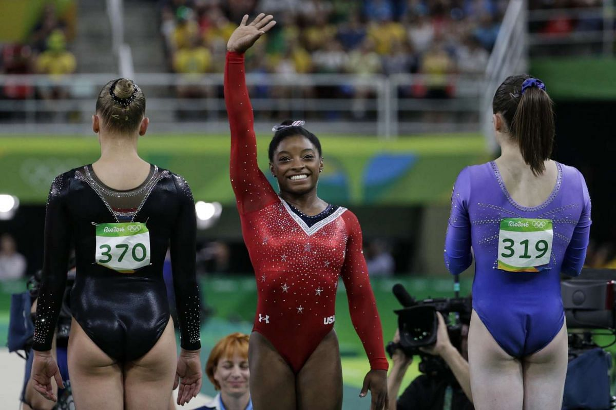Simone Biles of the US acknowledging her introduction during the Rio 2016 Olympic Games artistic gymnastics women's balance beam final at Rio Olympic Arena in Rio de Janeiro on August 15.