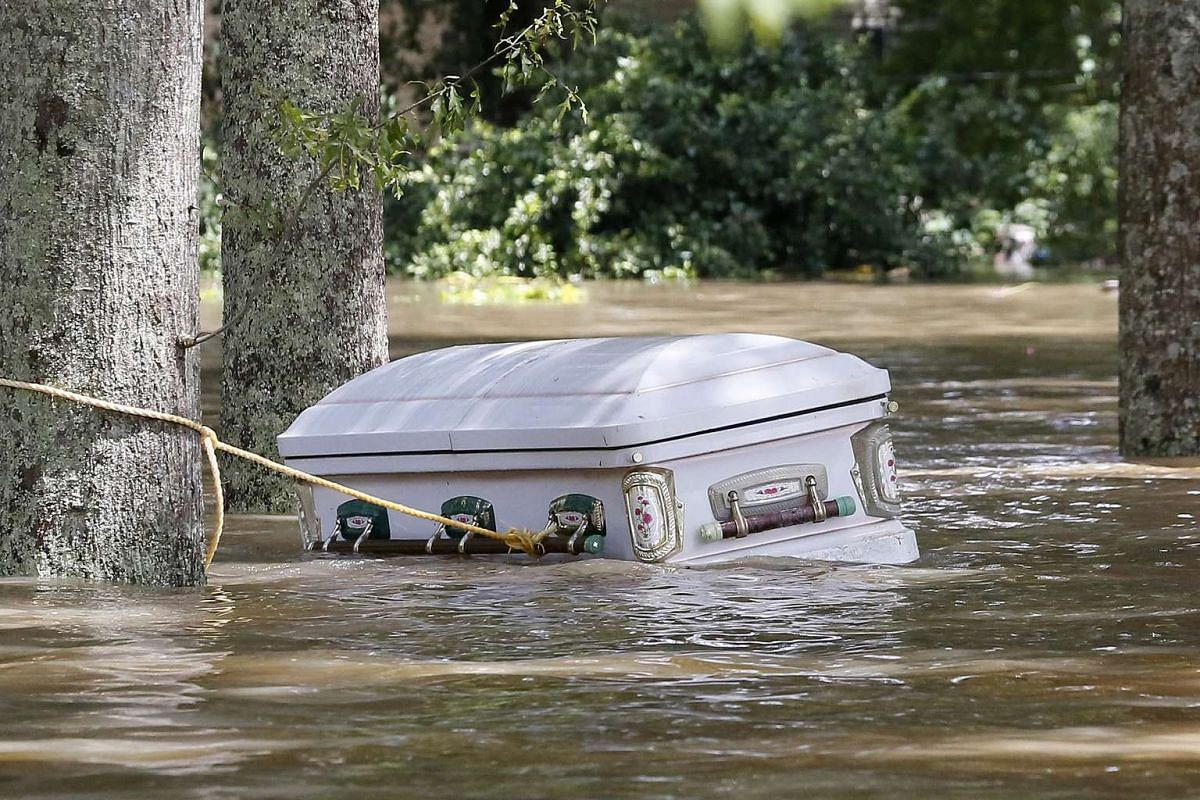 A casket is seen floating in flood waters in Ascension Parish, Louisiana, US, on August 15.