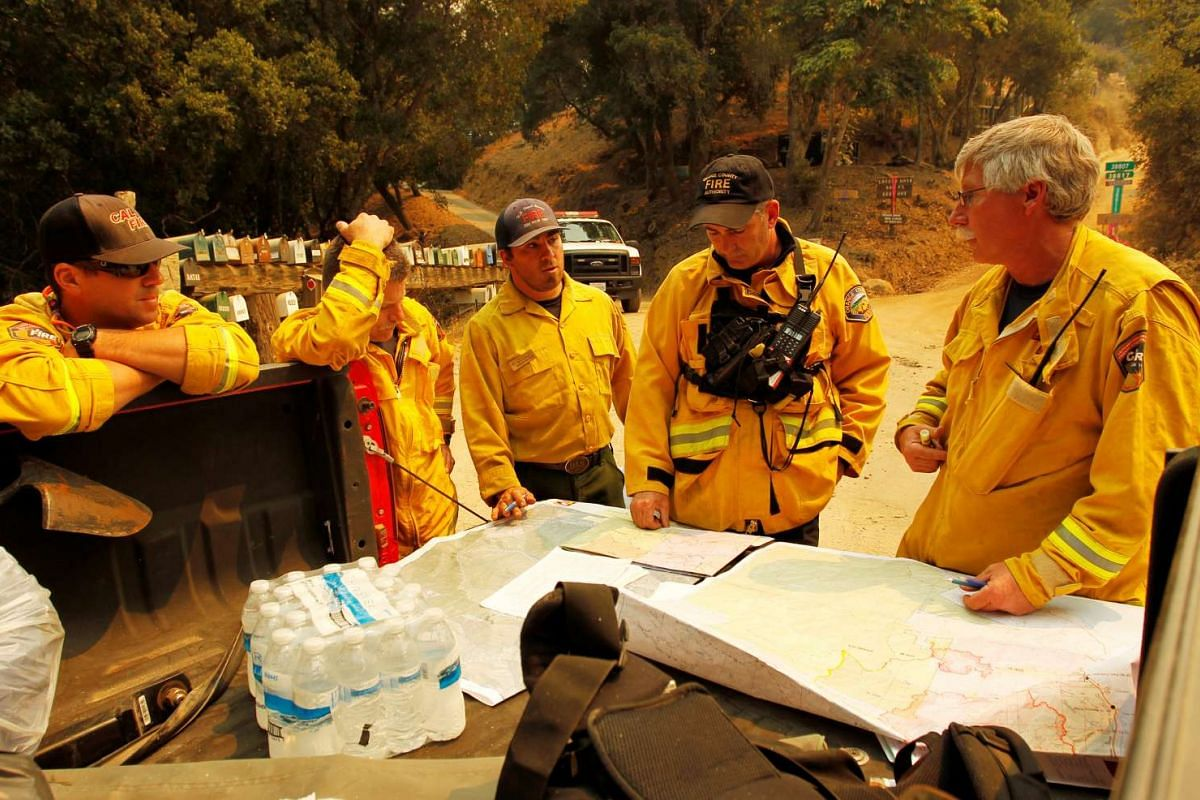 Cal Fire personnel use maps to strategise during the Soberanes Fire in the evacuated Palo Colorado area north of Big Sur, on July 25, 2016.