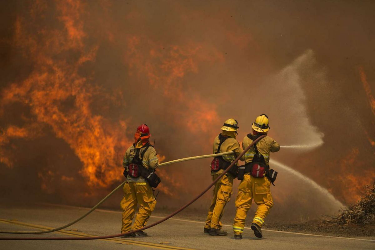 Firefighters battle flames in Placerita Canyon at the Sand Fire in Santa Clarita, California, on July 24, 2016.