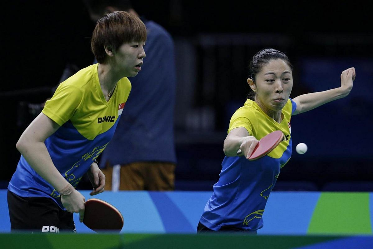 Yu Mengyu (right) and Zhou Yihan of Singapore in action against Japan's Ai Fukuhara and Mima Ito during the Rio 2016 Olympic Games table tennis women's team bronze play-off at Riocentro Pavilion 3 in Rio de Janeiro, Brazil, on August 16.