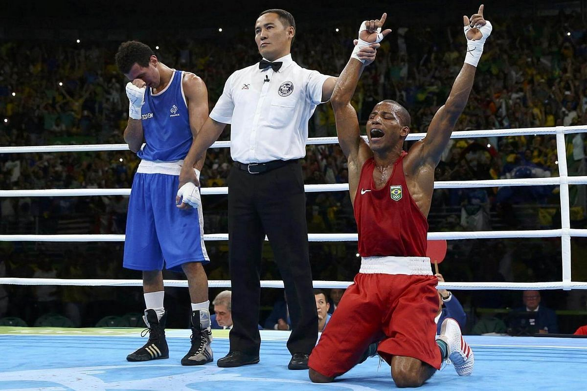 Robson Conceicao of Brazil celebrates after winning his bout against Sofiane Oumiha of France.
