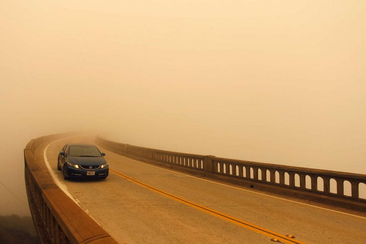 Smoke from the Soberanes Fire reduces visibility over Bixby Bridge on State Route 1 north of Big Sur, on July 26, 2016.