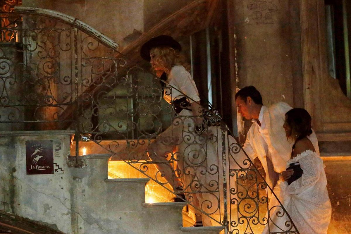 US pop star and singer Madonna (left) arrives at a restaurant in downtown Havana, Cuba on Aug 16.