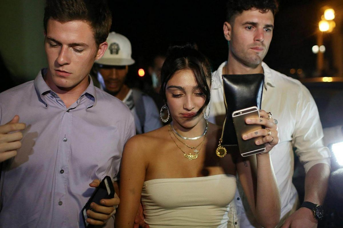 Lourdes Leon (centre), daughter of American pop star Madonna, leaves a hotel in Havana, Cuba, on Aug 15.