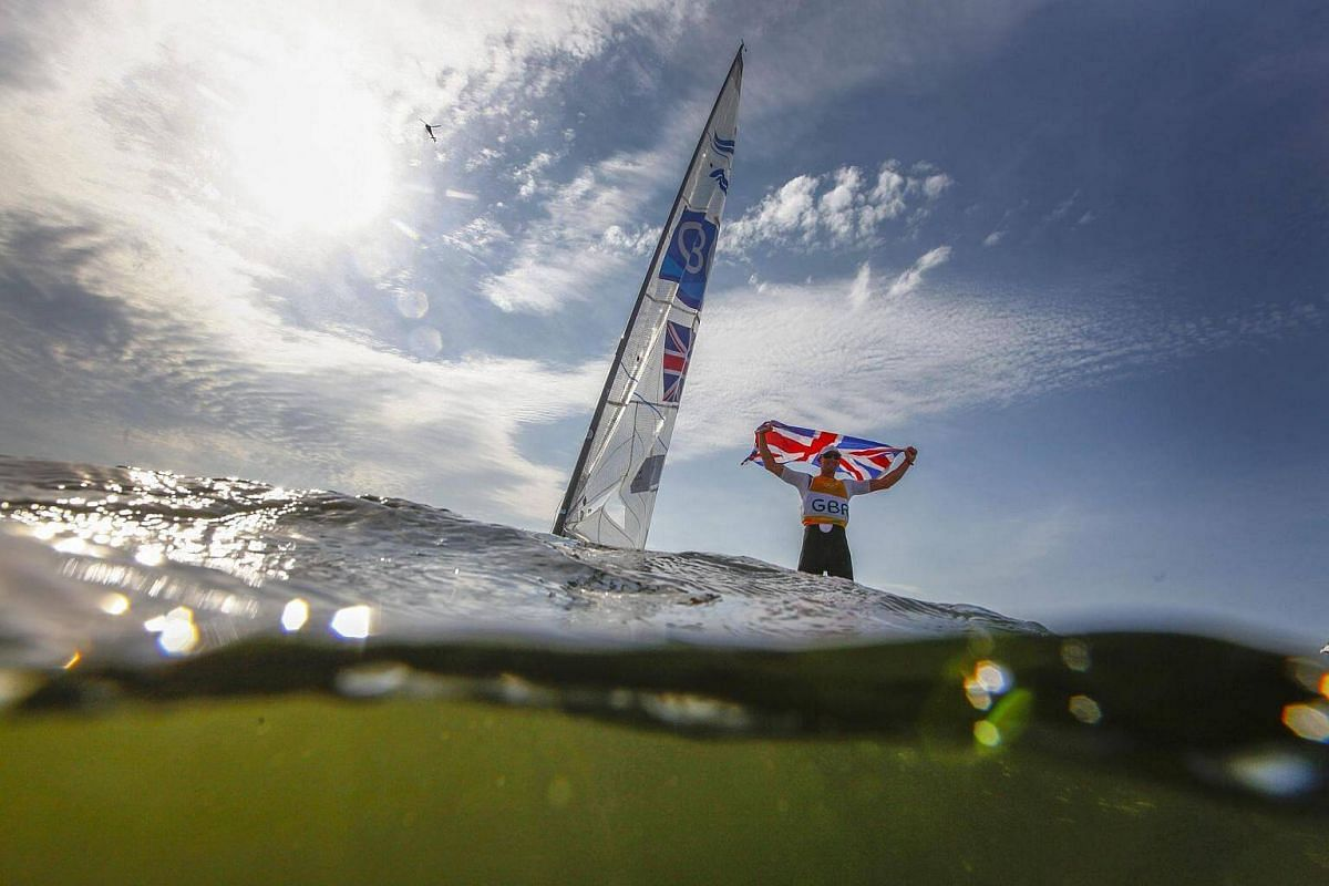 Giles Scott of Great Britain reacts after winning the gold medal in the men's Finn class medal race of the Rio 2016 Olympic Games Sailing events on August 16.