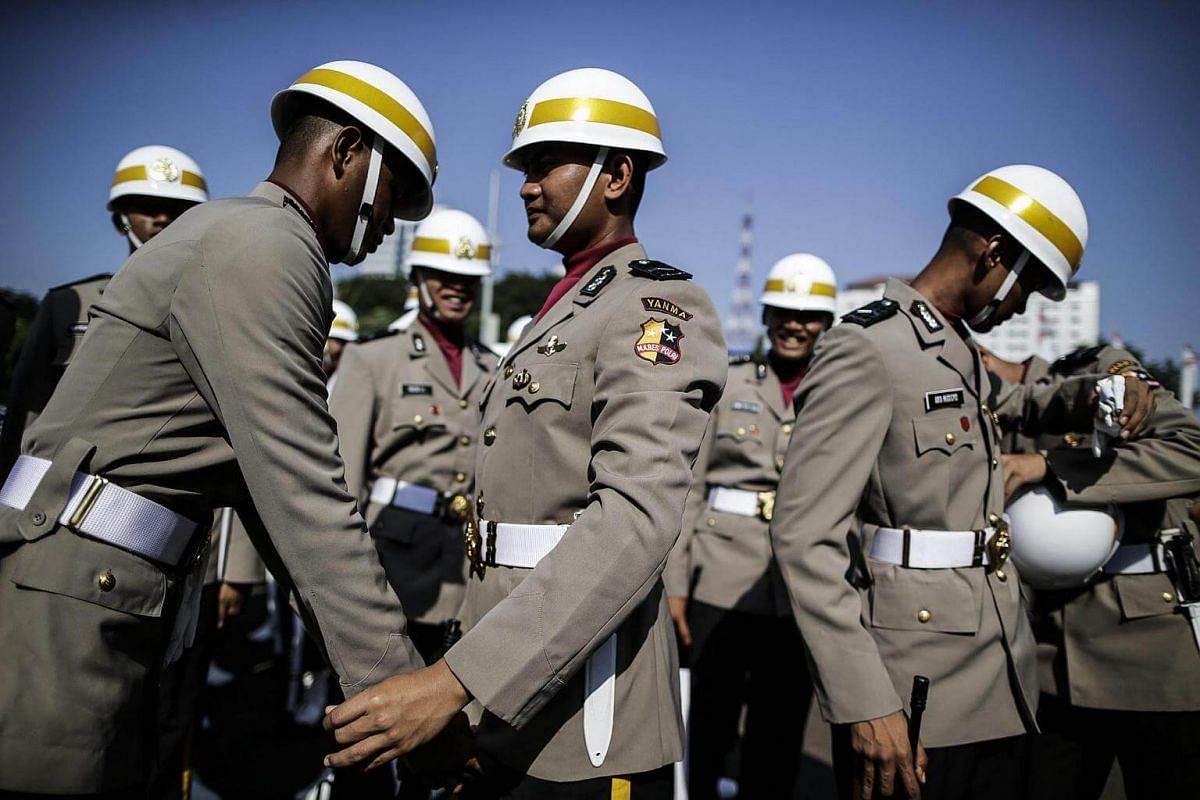 Indonesian police officers prepare for a parade to mark Indonesia's 71th independence anniversary outside the Presidential Palace in Jakarta, Indonesia, on August 17.