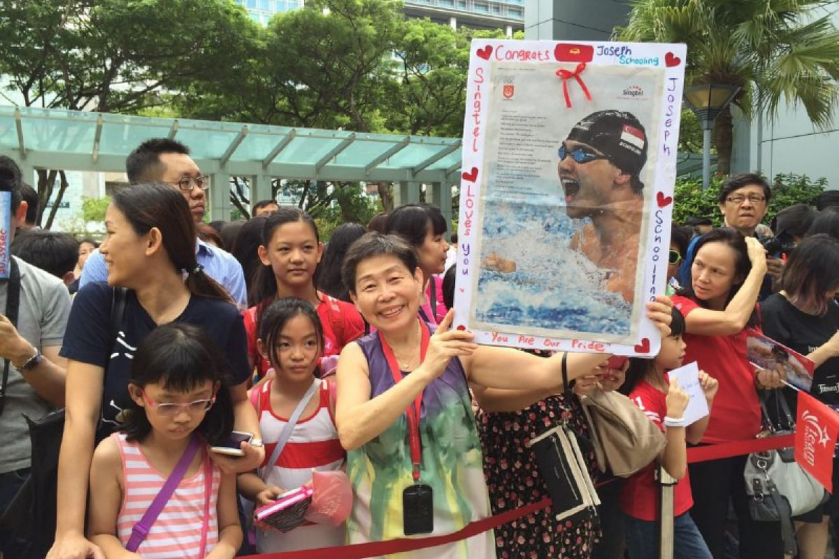 Ms Lim Chui Hai, 65, and her 20-man team at the Singtel Comcentre made a special poster for Joseph Schooling to sign.