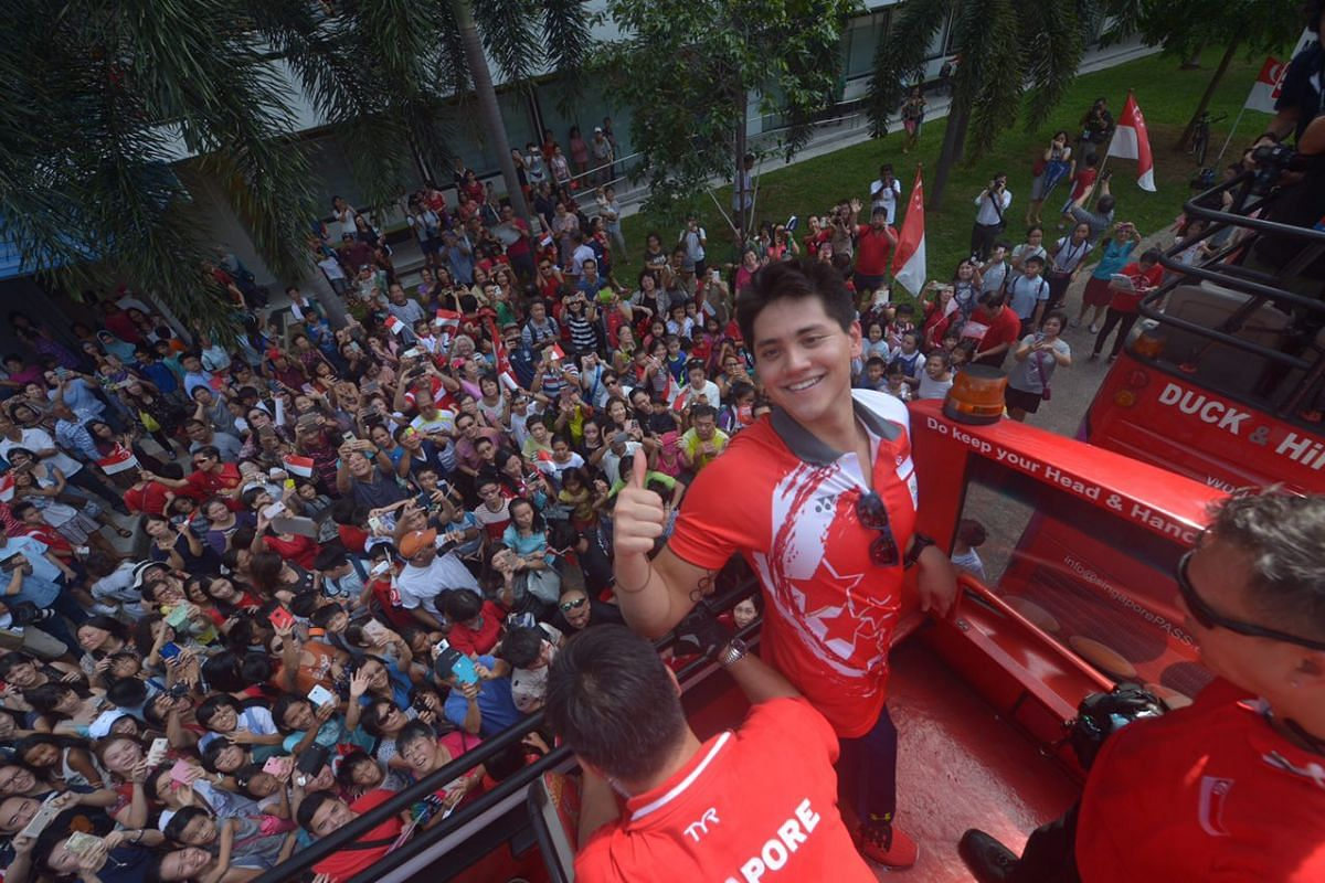 Joseph Schooling gives a thumbs up before leaving Marine Terrace.