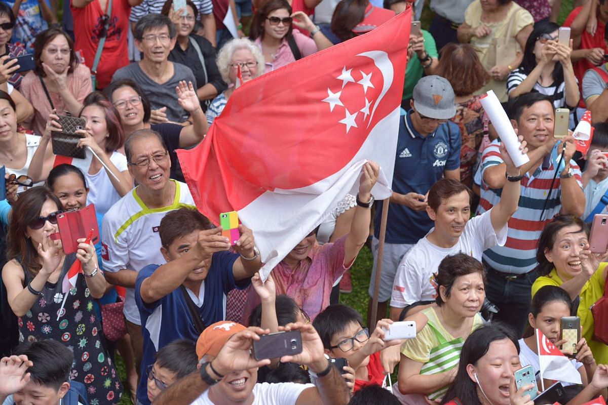 Fans take pictures of Joseph Schooling as he leaves Marine Terrace.