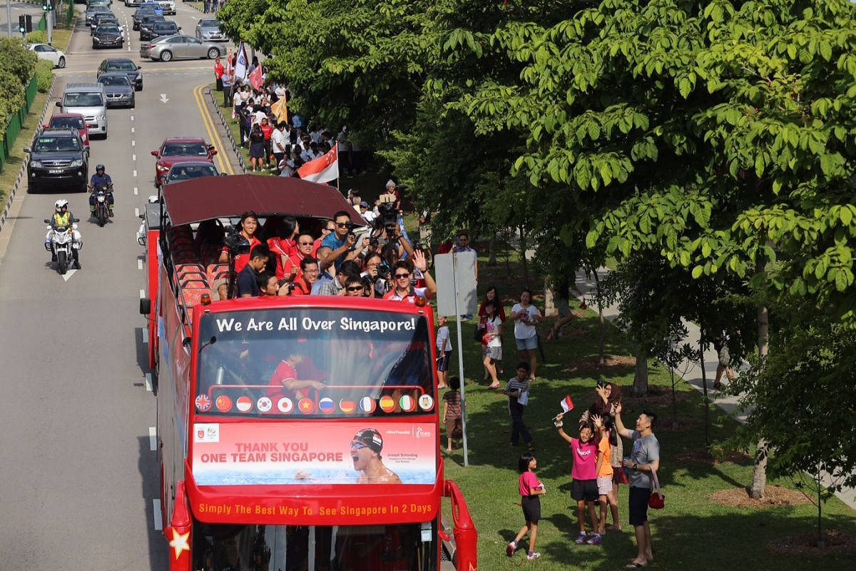 Broadrick students cheer as the parade bus travels along Old Airport Road.