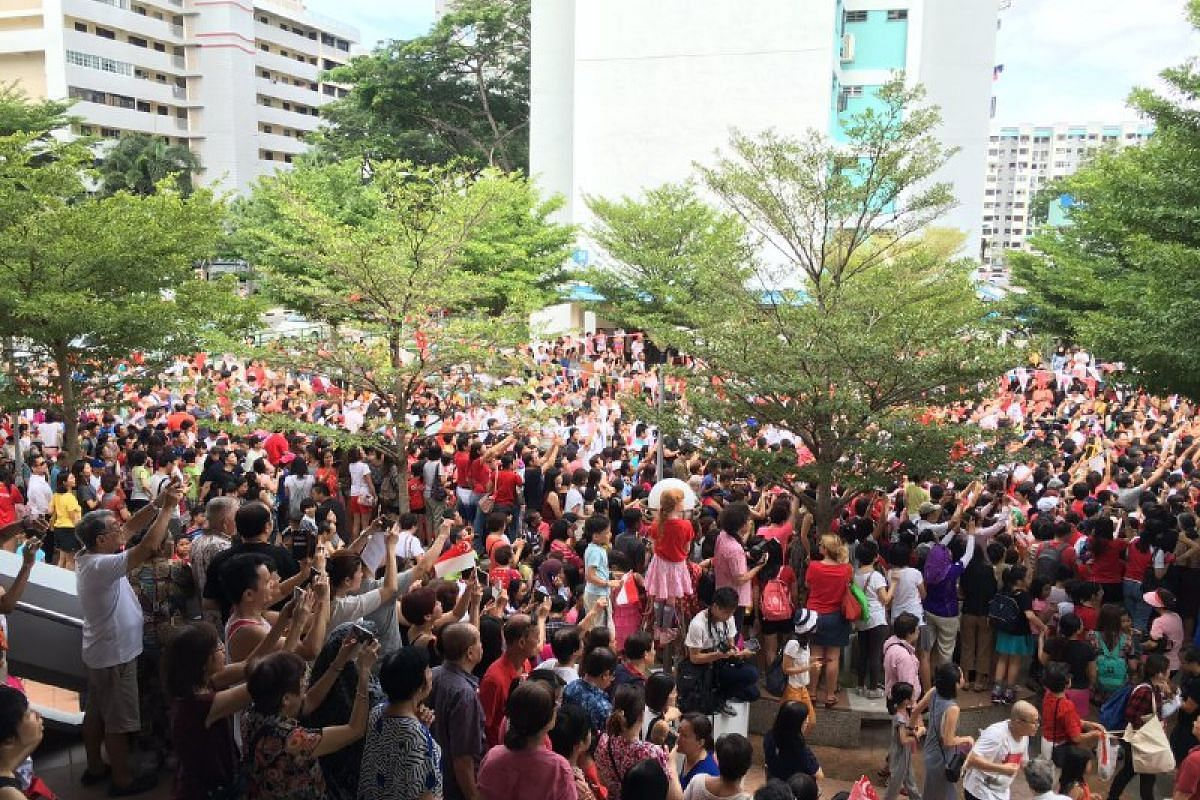 The crowd waits for Joseph Schooling at the first pit stop at Marine Terrace.