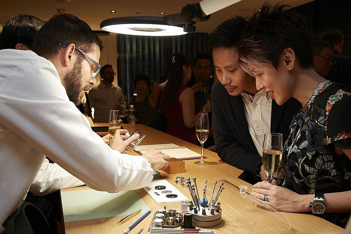 Top: The newly renovated Patek Philippe boutique at Ion Orchard. Above: Guests learning about timepieces from a watchmaker at the reopening of the Audemars Piguet boutique at Liat Towers in April after its renovation.