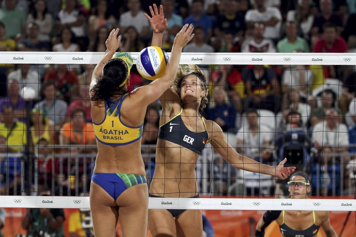 Agatha Bednarczuk of Brazil and Laura Ludwig of Germany compete in beach volleyball women's gold medal match in the 2016 Rio Olympics on August 17.