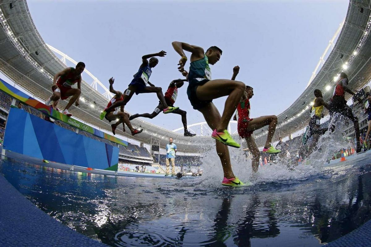 Altobeli da Silva (centre) of Brazil competes during the men's 3000m steeplechase final of the Rio 2016 Olympic Games Athletics, Track and Field events on August 17.