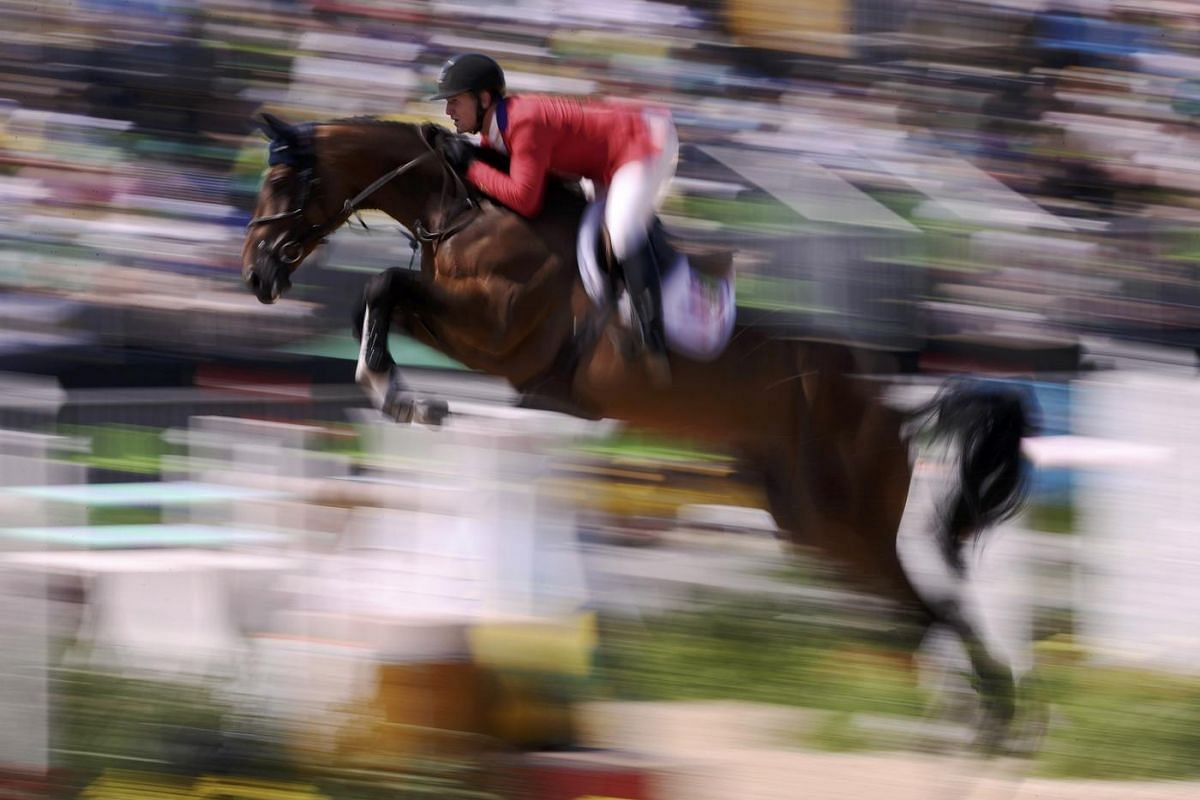 McLain Ward of USA riding Azur jumps during a jumping team finals at Olympic Equestrian Centre during the Rio Olympics on August 17.