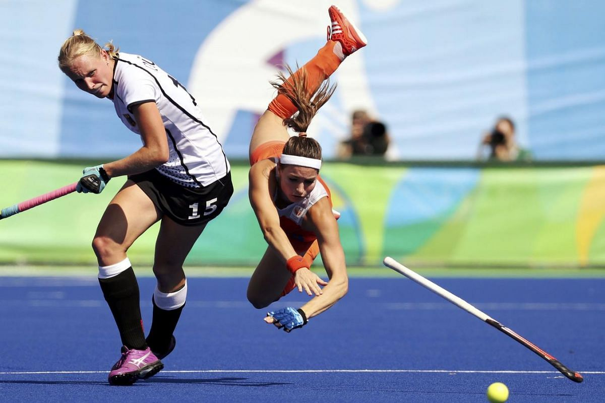 Eva de Goede of Netherlands (right) falls while competing against Hannah Kruger of Germany in the Olympic Park in Rio de Janeiro, Brazil on August 17.