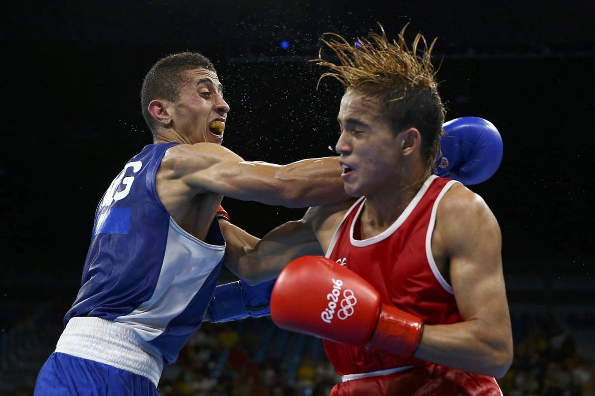 Yoel Finol of Venezuela and Mohamed Flissi of Algeria compete in a men's fly quarter-finals Bout 247, in the Riocentro Pavilion 6 in Rio de Janeiro, Brazil on August 17.