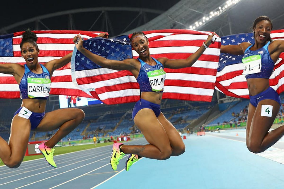 Brianna Rollins of USA celebrates winning the gold medal with silver medallist Nia Ali of USA and bronze medallist Kristi Castlin of USA for women's 100m hurdles final at Rio de Janeiro, Brazil, on August 17.