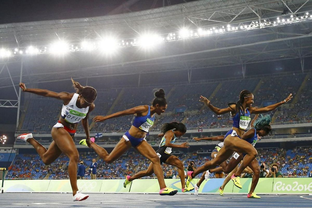Brianna Rollins of USA crosses the finish line to win the gold, ahead of silver medallist Nia Ali of USA and bronze medallist Kristi Castlin of USA compete in women's 100m hurdles final on August 17.