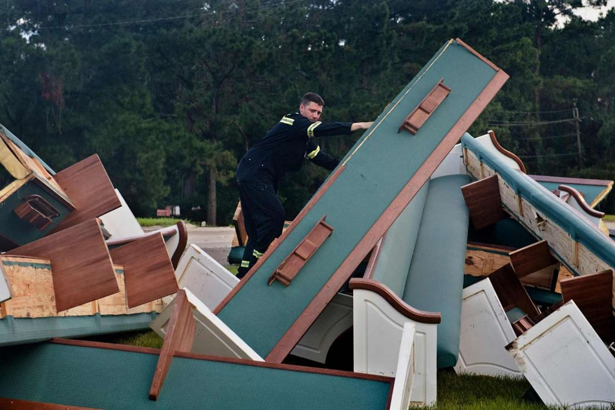 Kris New marks flood damaged pews outside the Life Tabernacle Church on August 15 in Baton Rouge, Louisiana.