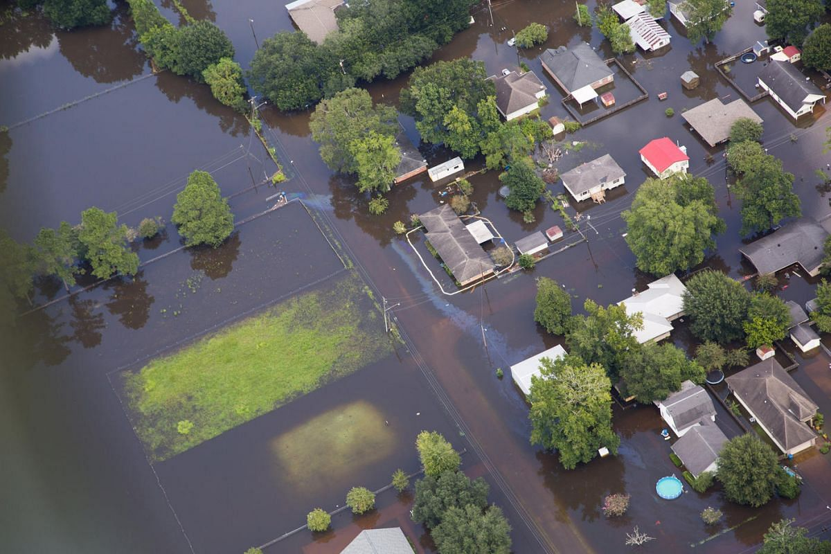 Contaminated floodwaters impact a neighborhood as seen in an aerial view in Sorrento, Louisiana, US on August 17.