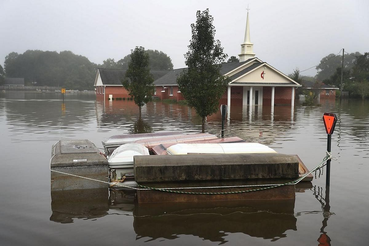 Caskets are seen floating in flood waters near a cemetery on August 17 in Gonzales, Louisiana.