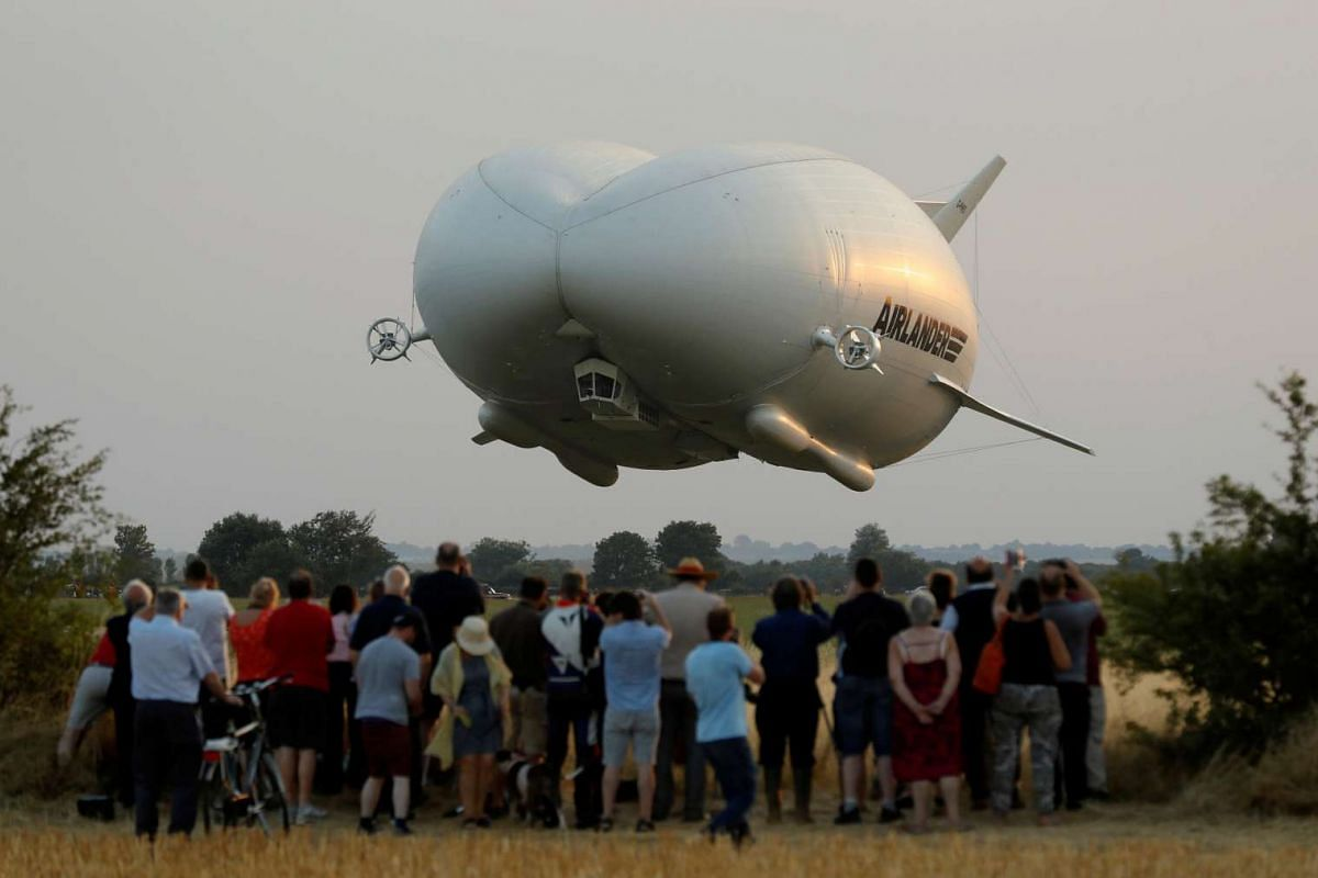 The Airlander 10 hybrid airship making its maiden flight at Cardington Airfield in Britain, on Aug 17, 2016.