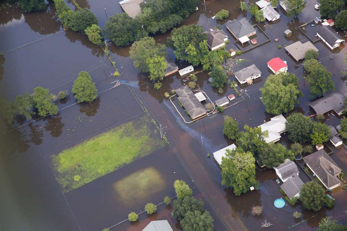 Contaminated floodwaters are seen in a neighborhood in an aerial view in Sorrento, Louisiana, on Aug 17, 2016