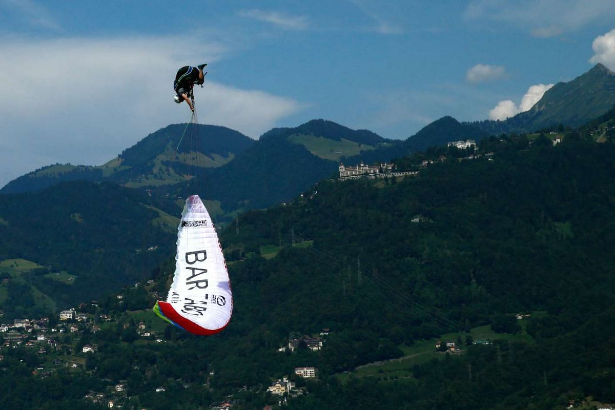 Pilot Morane Montavon of the Swiss Acro League performing an infinity tumbling manoeuvre while paragliding above Lake Leman during a training session before the Acroshow competition in Villeneuve, Switzerland, on Aug 17, 2016.
