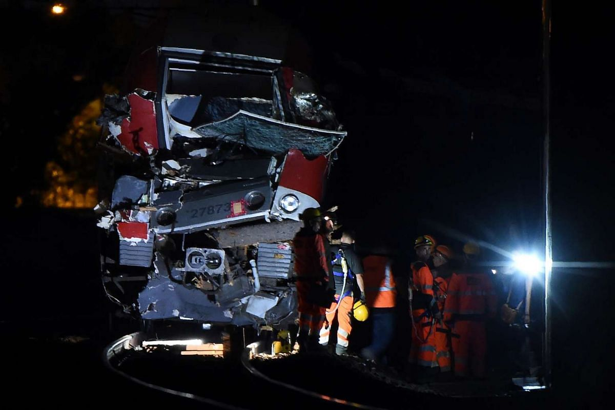 Emergency personnel standing by the wreckage of a train wagon following its crash in Saint-Aunes, near the French city of Montpellier, on Aug 17, 2016.