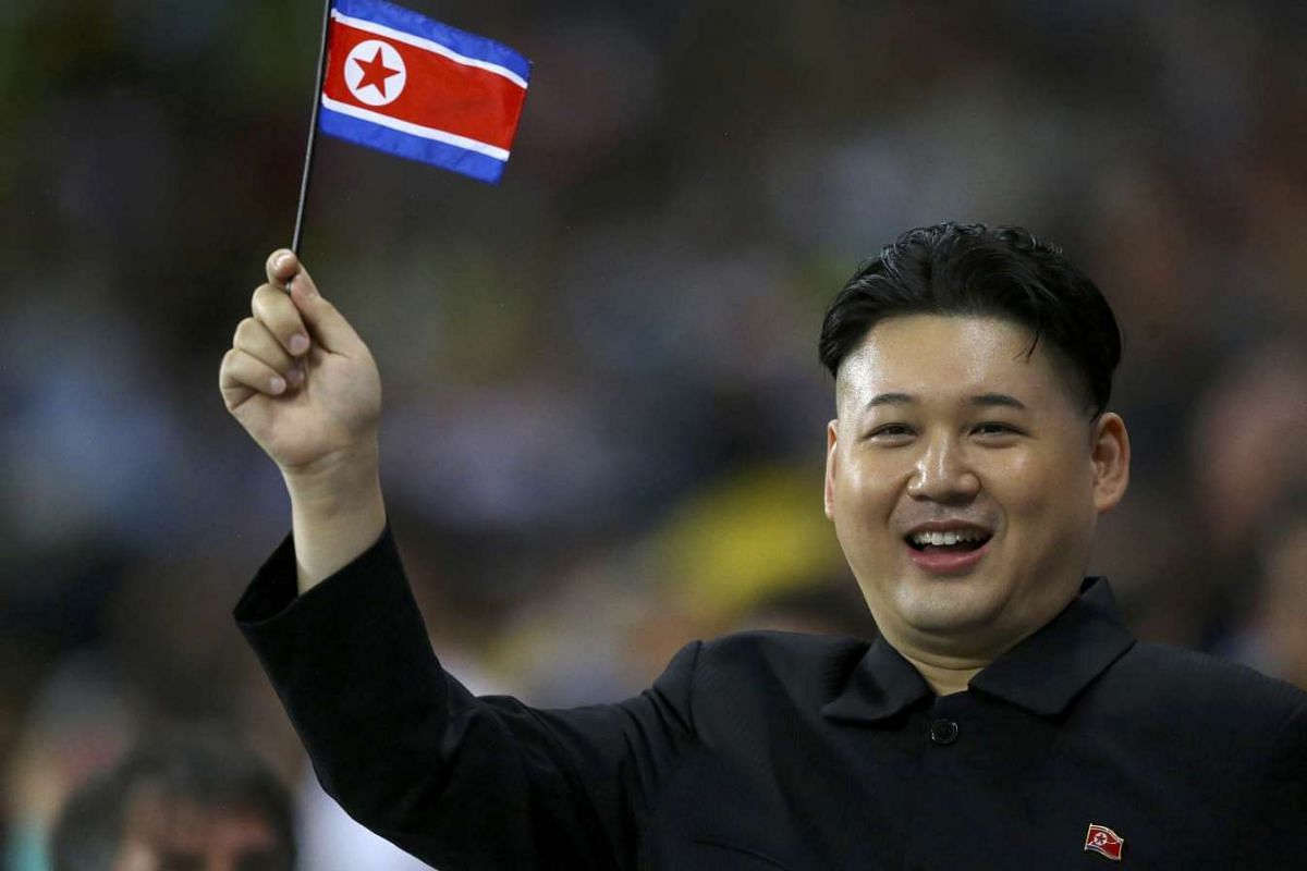 A North Korean supporter waves their national flag at the Rio Olympics in Rio de Janeiro, August 18, 2016. PHOTO: REUTERS