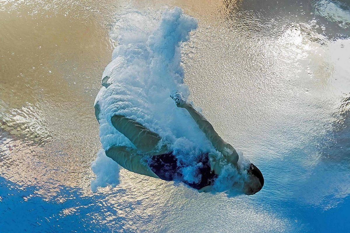 An underwater shot of  North Korea's Kim Un Hyang taking part in the women's 10m platform semi-final during the diving event.