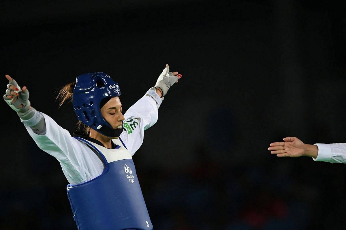 Spain's Eva Calvo Gomez celebrates after winning against Egypt's Hedaya Wahba in their women's taekwondo semi-final bout in the 57kg category.