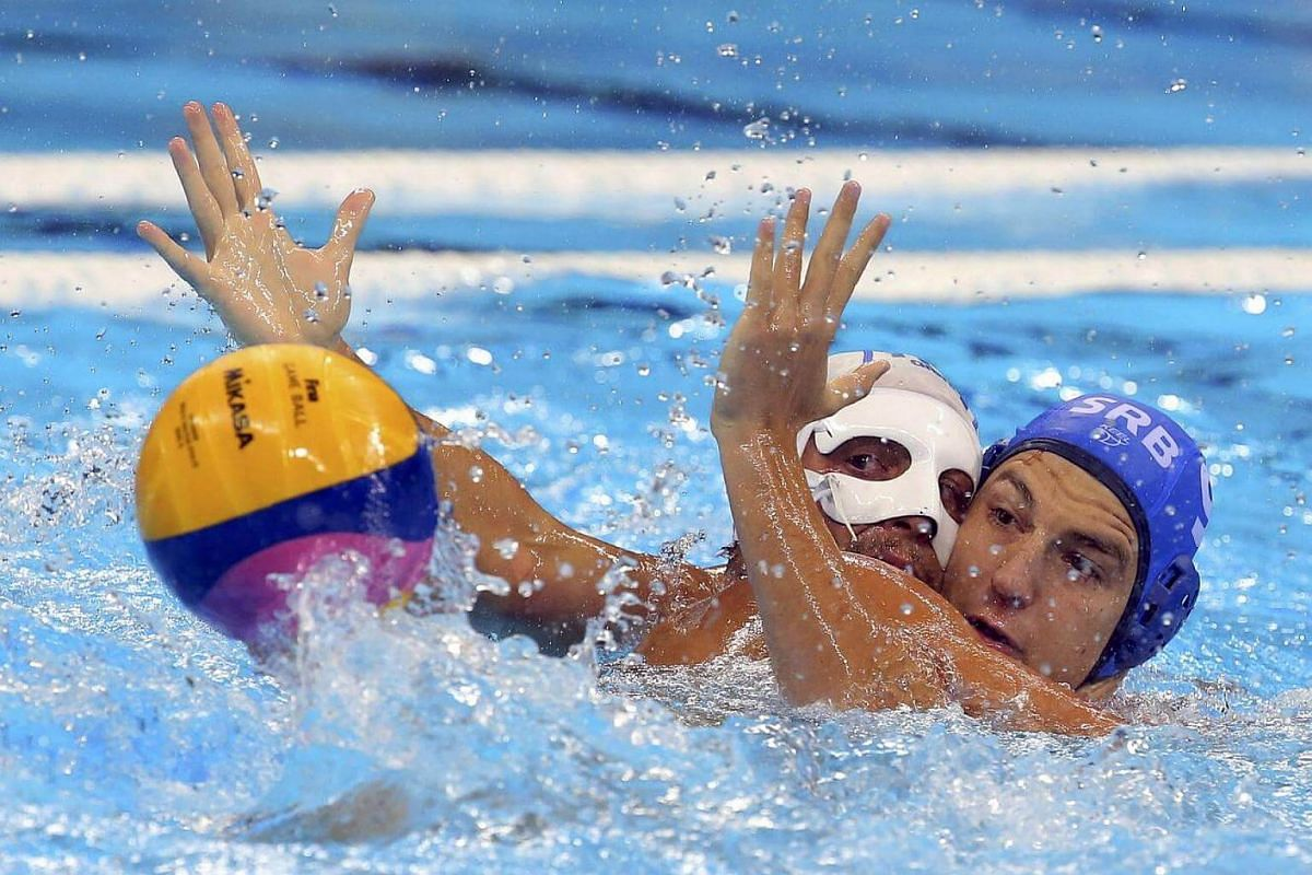 Matteo Aicardi of Italy (left) and Nikola Jaksic of Serbia compete in the men's water polo semi-final.