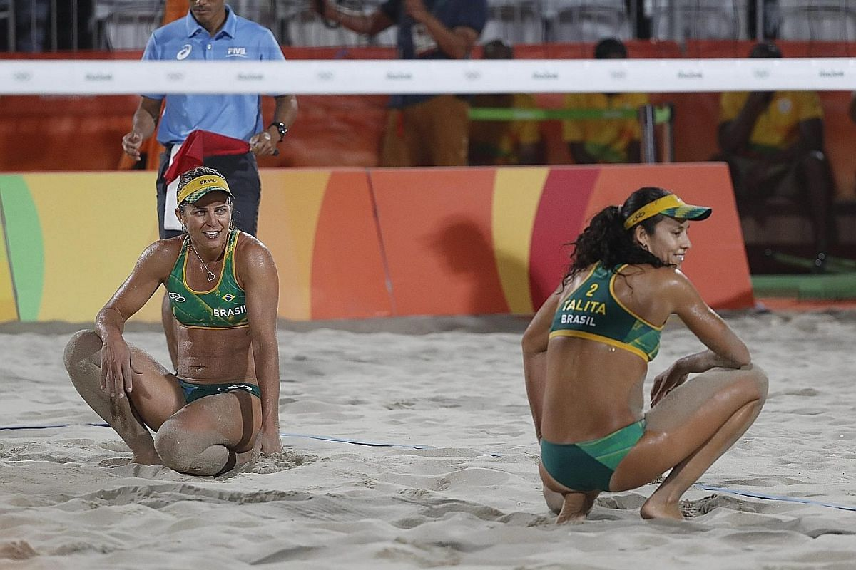 Brazil's Talita Rocha (right) and Larissa Franca after scoring a point against the United States in the bronze-medal match.