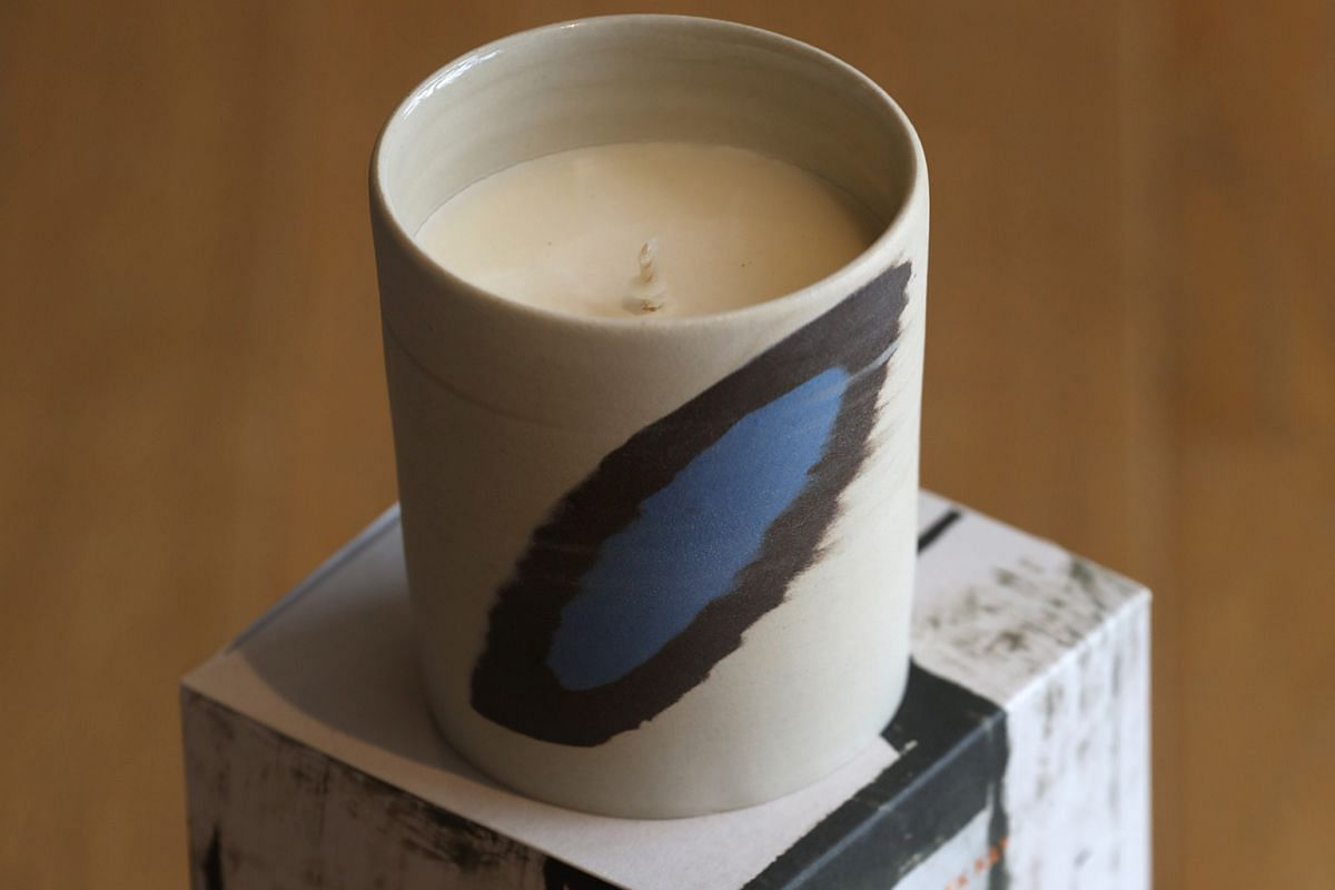 Candles Of Light's candle (above) with a scent inspired by a painting by artist Chua Ek Kay, available at Gallery & Co.