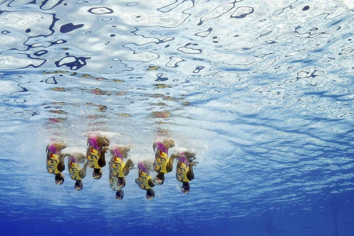 Team Japan competes in the free routine final of the synchronised swimming event.
