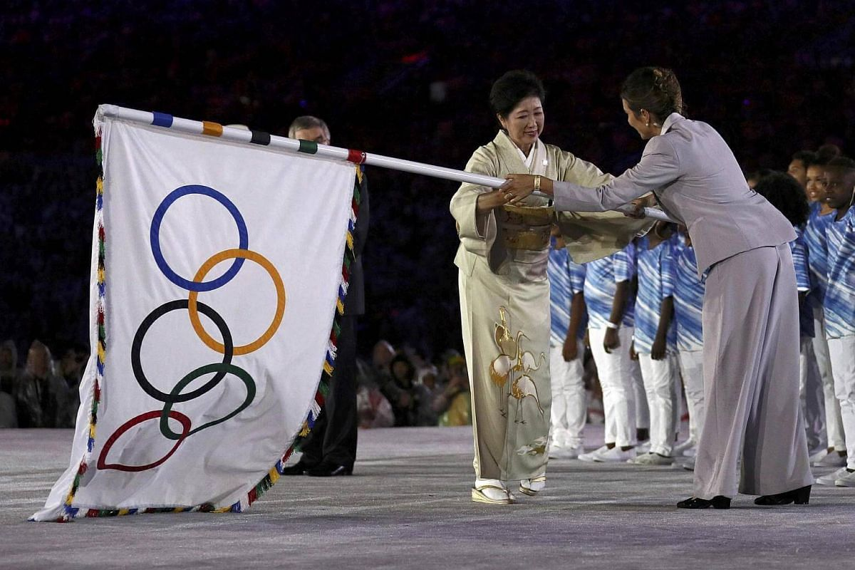 Tokyo governor Yuriko Koike takes the Olympic flag on stage during the closing ceremony of the Rio 2016 Olympic Games on August 21.