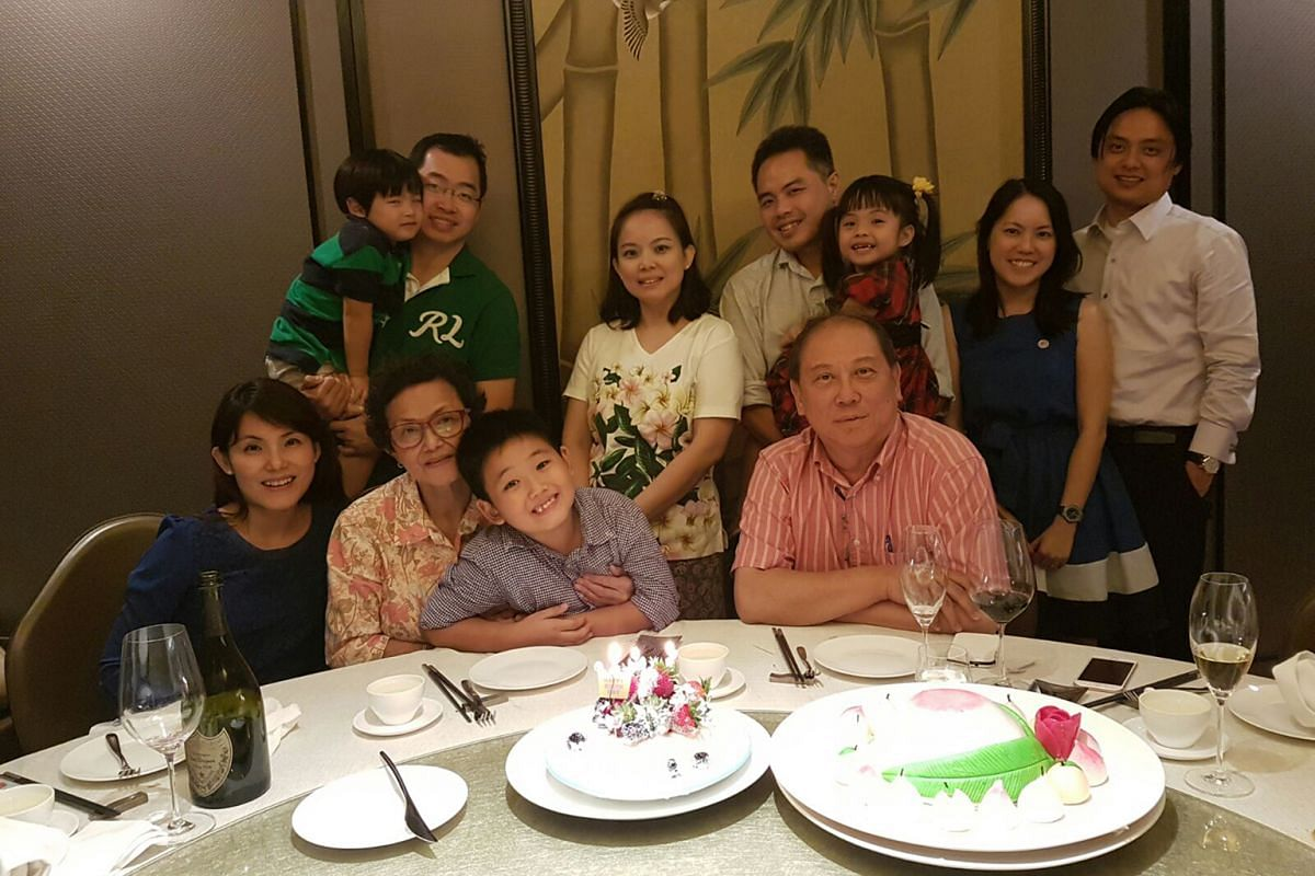 Mr Don Tay with his wife May Ngoh and their daughters Claudean, Janarie and Delia, in their HDB maisonette in Bishan in the 1980s, and celebrating his 65th birthday this year with his family, sons-in-law and grandchildren (above).