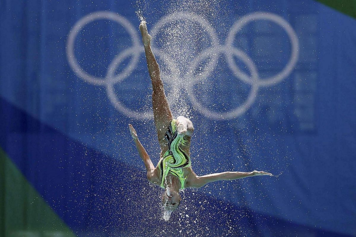 Team Ukraine competes in the technical routine final of the synchronised swimming event in the Rio Olympics.