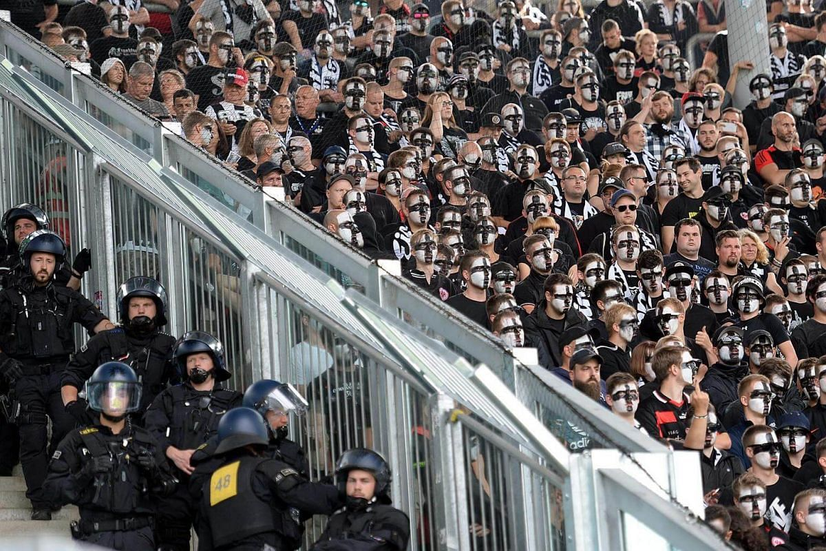 Police officers position themeselves next to Frankfurt fans during the DFB German soccer cup match between FC Magdeburg and Eintracht Frankfurt on August 21.
