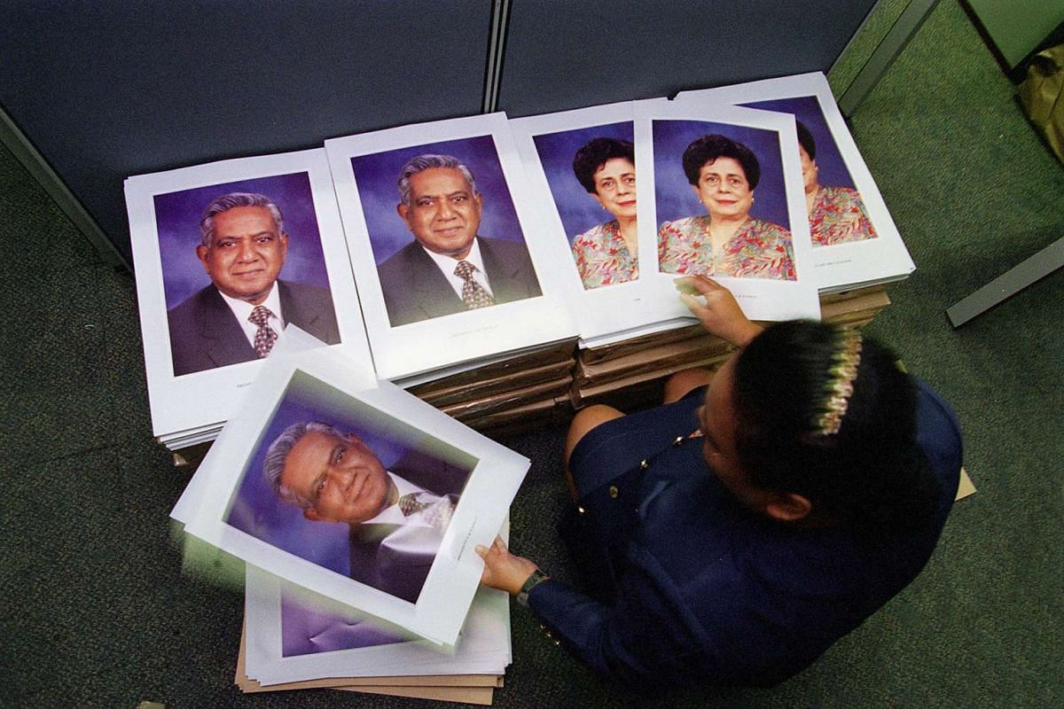 Portraits of Mr and Mrs S R Nathan before being distributed to ministries and statutory boards in 1999.
