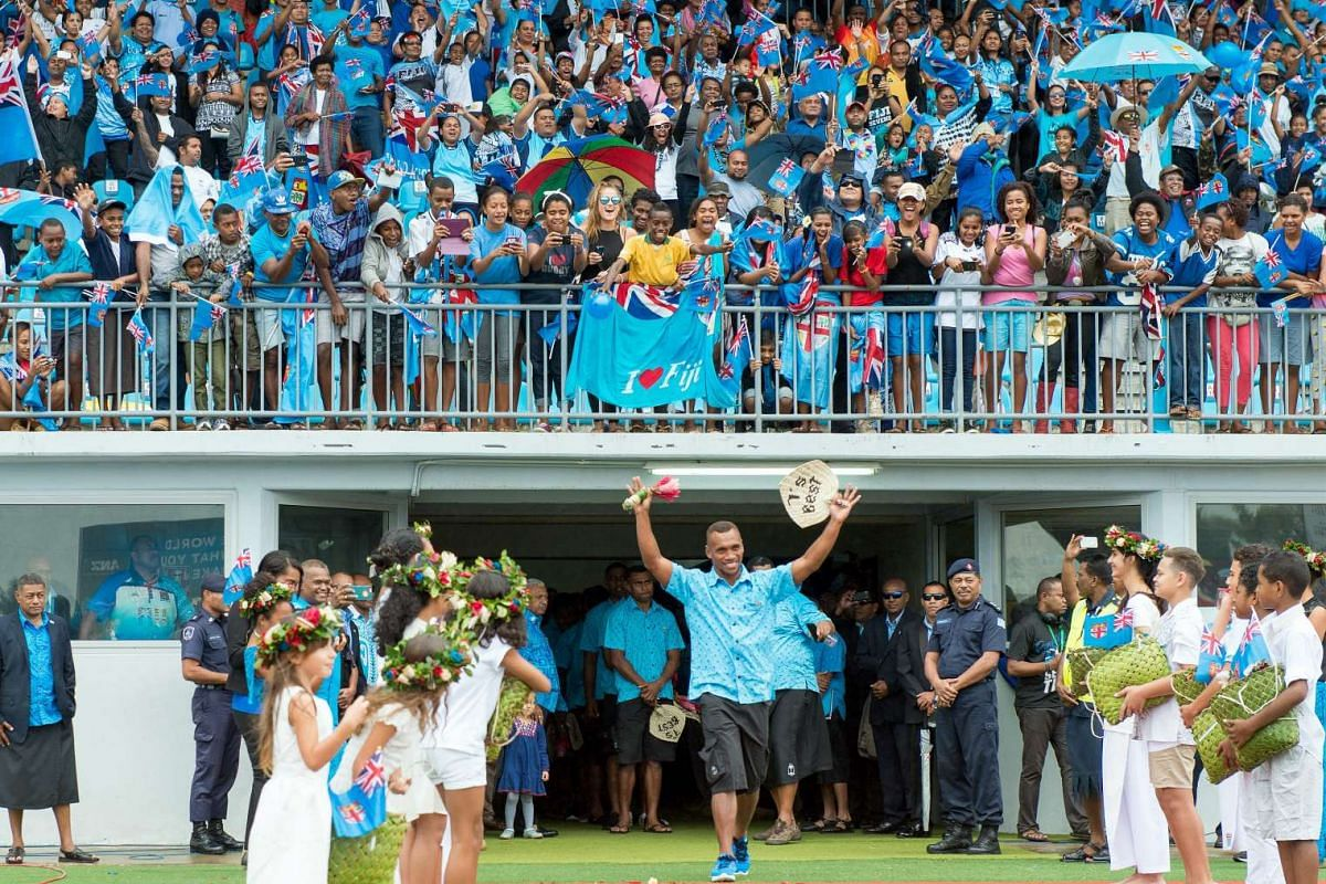 Fiji's Rio Olympics rugby sevens gold medalists enter in a stadium in Suva upon their arrival from Brazil on Aug 22, 2016.