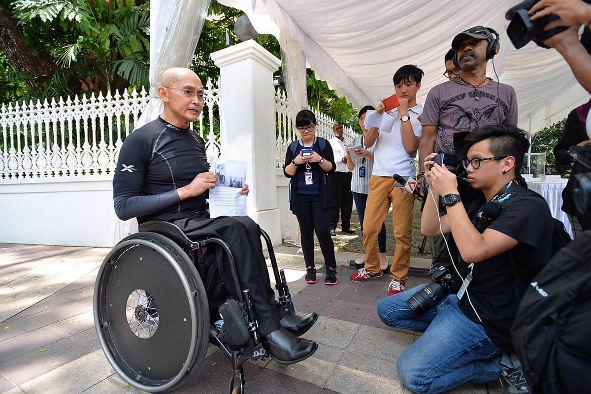 Paralympian Dr William Tan,59, at the Istana. He spoke of the time he received help from Mr Nathan after he was diagnosed with stage 4 leukaemia. Mr Nathan autographed his book which helped to raise funds for his cancer treatment.