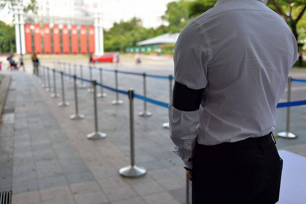 A guard watches over preparations at the Istana.