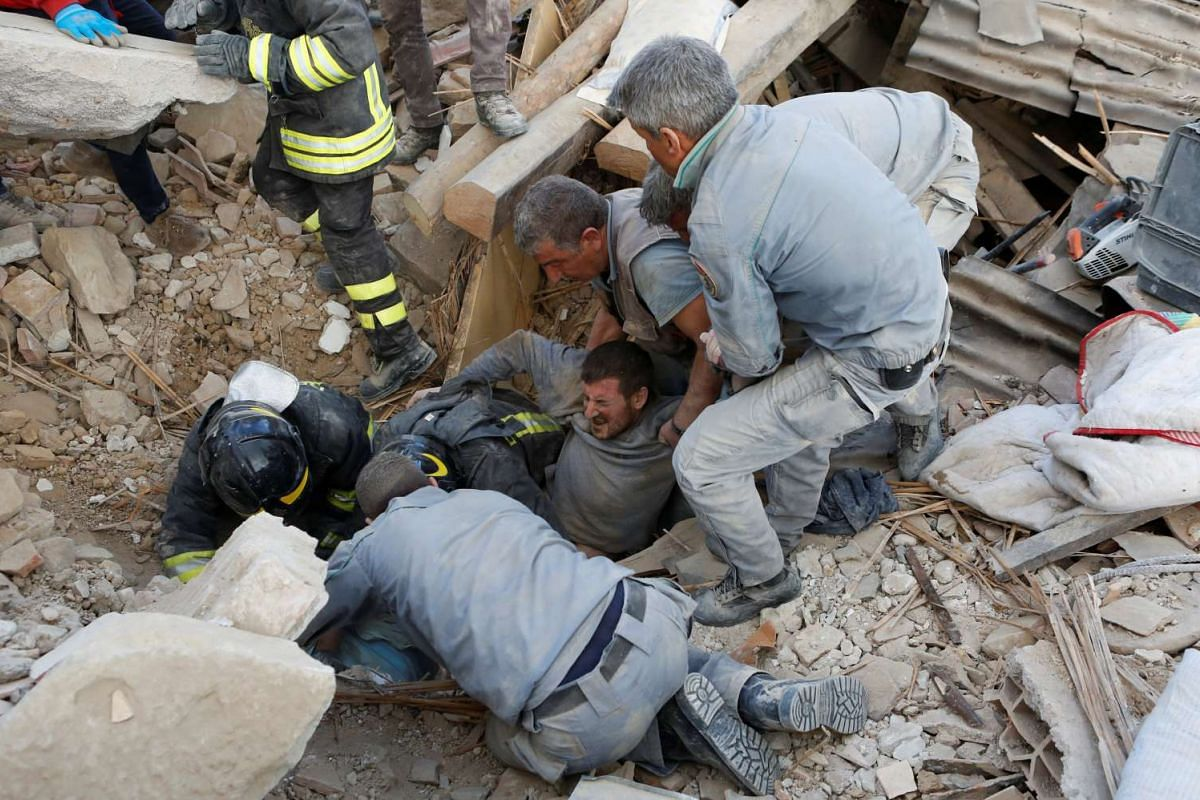 A man is rescued alive from the ruins following an earthquake in Amatrice, central Italy, on Aug 24, 2016.